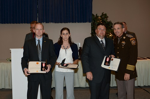 Pictured from left to right at the CCSO 2013 Awards and Retirement Banquet are Officer Michael Armstrong, Officer Jena Hatfield, Cpl. John Freeman and Sheriff Rex Coffey. Sheriff Coffey presented the officers with bronze medals of valor for their actions.