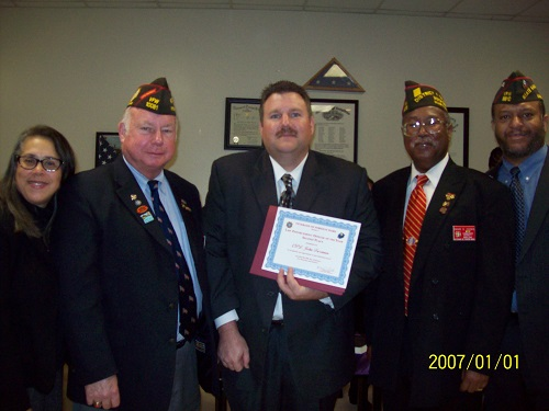 Pictured form left to right are Melanie Holland, VFW/LE/Fire/EMS Programs; Carl Vogt, Immediate Past State MD VFW Commander; Cpl. John Freeman; District 1 Commander David Cooks; and Edward Holland, chair, VFW LE/Fire/EMS Programs. Photo courtesy VFW.