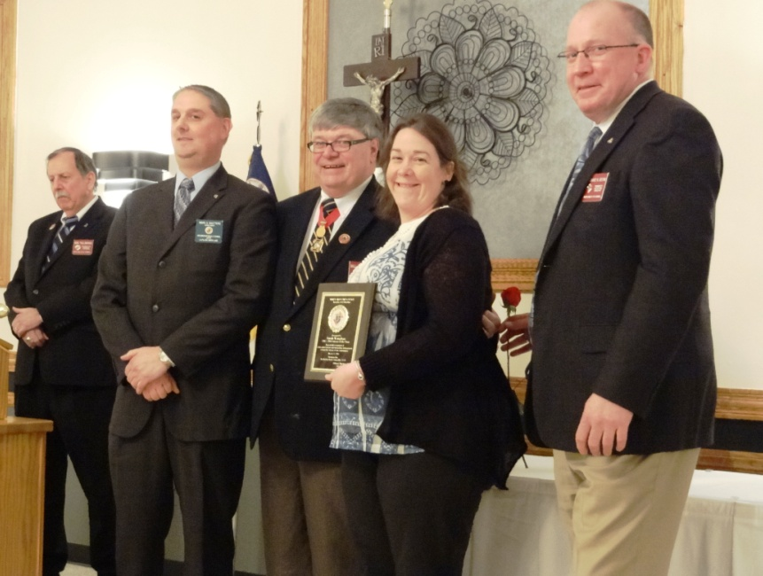 The Knights of Columbus presents Ms. Vaughan with her award.