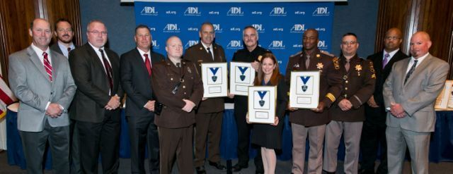 CCSO Cpl. Richard Boggs, third from the right, and members of the police department, sheriff's office, and state's attorney's office in Montgomery County, are presented awards from the Anti-Defamation League. CCSO Major Marvin Butler, fourth from right, is also pictured.