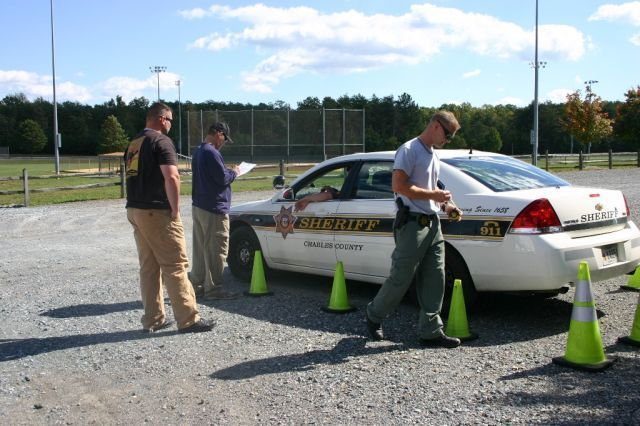 At a vehicle rodeo competition held during Charles County's annual Health and Wellness Fair, judges assess a CCSO officer's parking skills. Three CCSO officers earned top spots in the competition, which promotes safe driving.