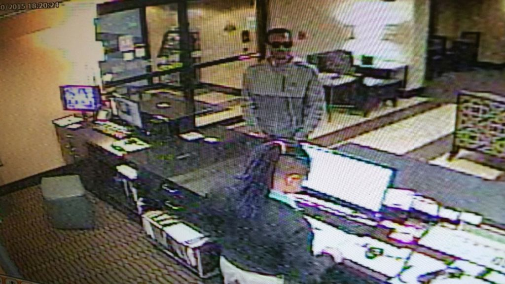 suspect in theft of credit card information (2)