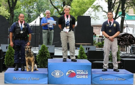 Cpl. Renee Cuyler receives her Gold Medal in the Police Service Dogs Vehicle Search Explosives Detection Competition