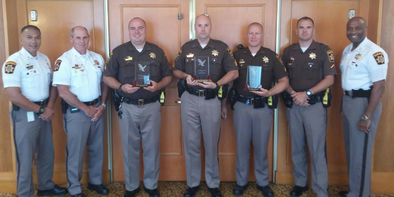 From left to right: Lt. Rey Aportadera, Capt. Kevin Barrows, Cpl. Kristian Syvertsen, Sgt. Jon Burroughs, Cpl. Shayne Stanley, Pfc. Craig Collins and Sheriff Troy Berry