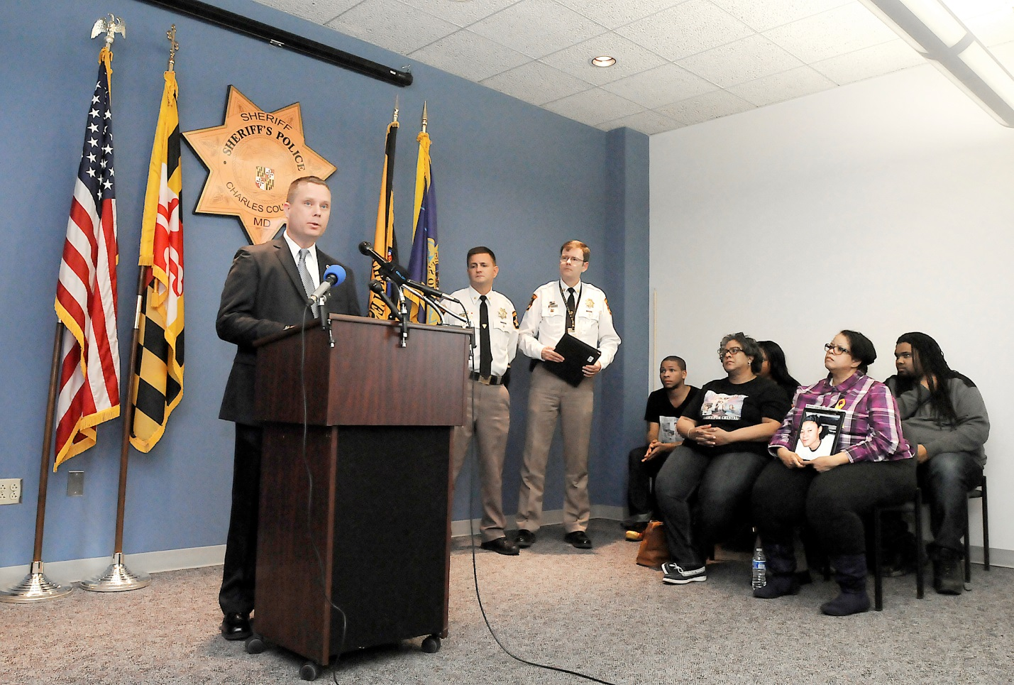 Detective John Elliott, the lead Detective in the case, answers media questions (Photo Courtesy of the Maryland Independent)