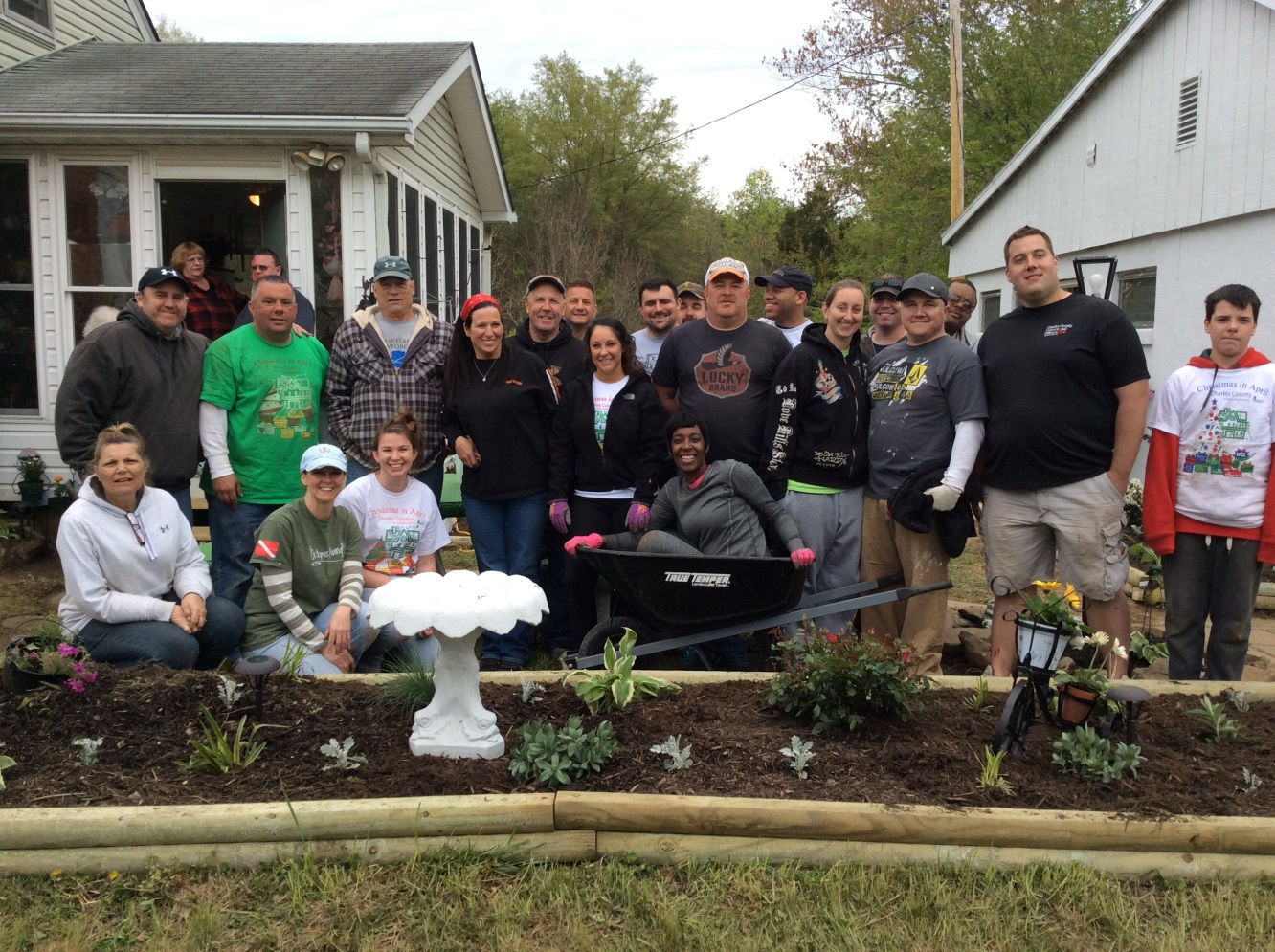 CCDC employees and family members spruced up the yard of a 91-year-old widow whose husband fought in WWII