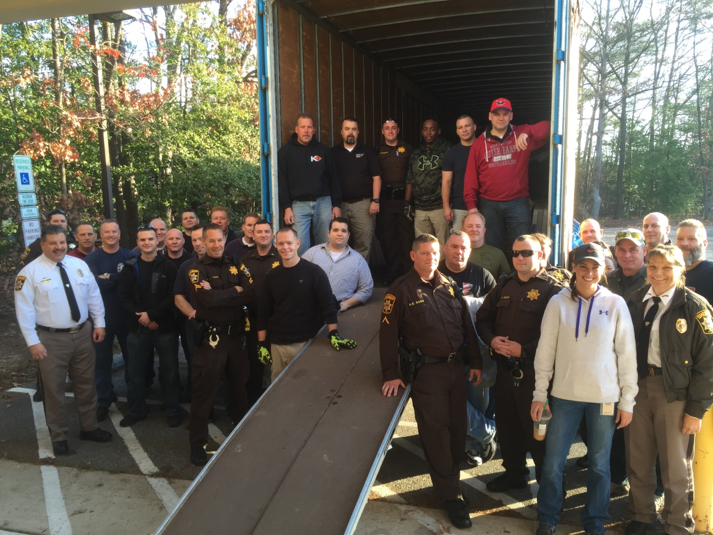 CCSO officers and civilian employees load a truck with donations for the Christmas Connection program