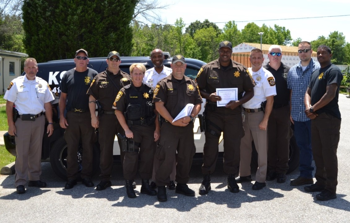 From left to right: Capt. Dan Gimler, Cpl. Sean Brown, Sgt. Haven Smith, Cpl. Renee Cuyler, Sheriff Troy Berry, PFC Colby Shaw, PFC Byron Clark, Maj. Chris Becker, Mr. William Cotton, PFC Darin Behm, and PFC Kevin Makle