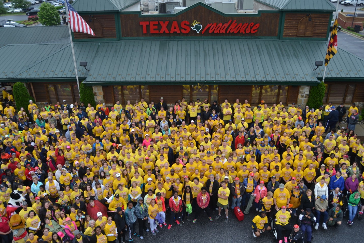 Participants in the Law Enforcement Torch Run gathered at Texas Roadhouse in La Plata before the start of the race