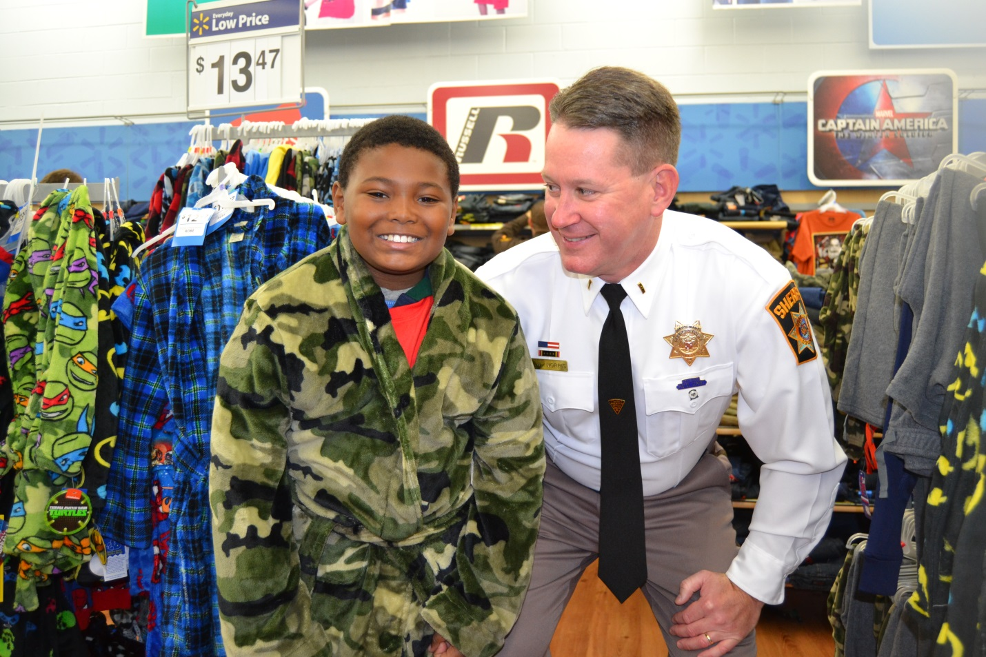 Lt. Jon Norris with his shopping partner at the 8th Annual Shop With a Cop event